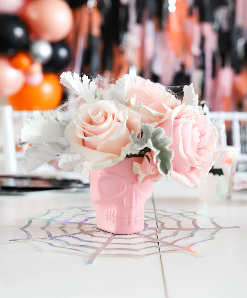 How Sweet Catherina Loves Petals Halloween Spooktacular flower rose arrangements in pink skull vases - A Little Confetti Party Blog