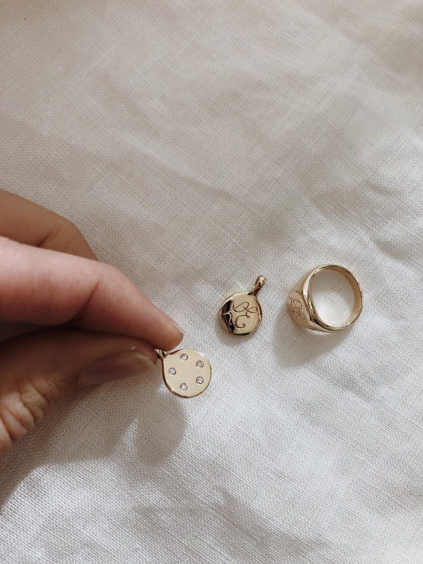 Nat's Signet Ring and Family Pendants