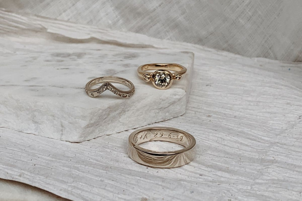 RUUSK custom gold wedding bands for him and her. Yellow gold diamond engagement ring.
