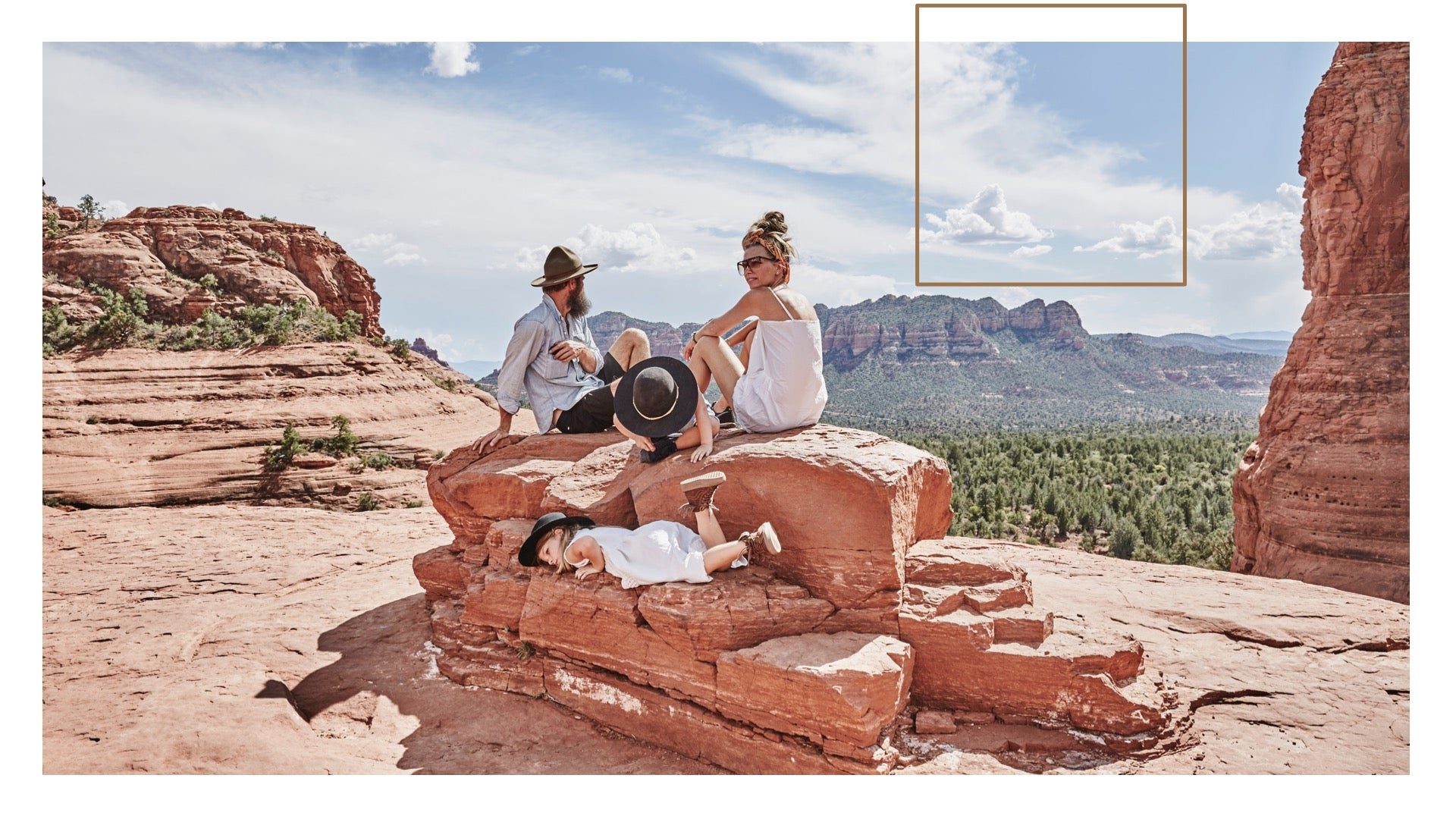 An image of Sheree and her family on a stack of red rocks in the middle of the American Southwest