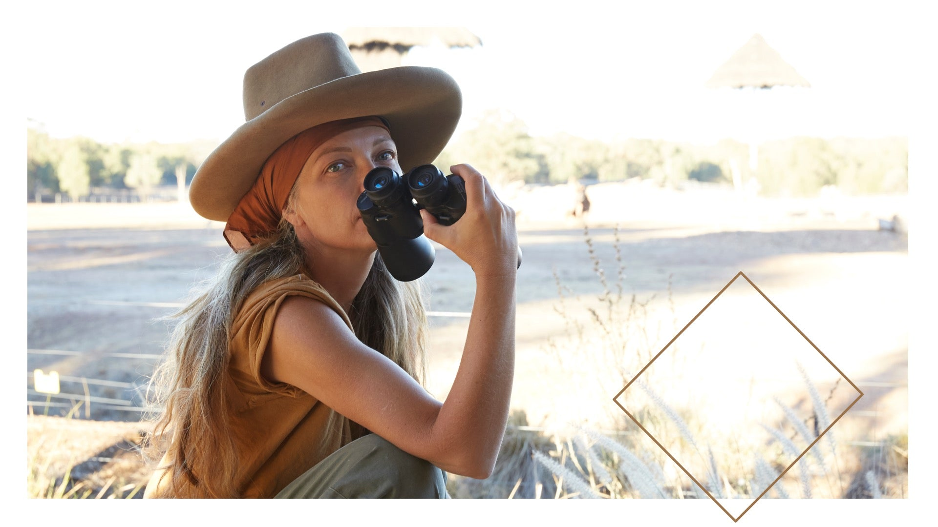 Sheree sitting outside holding a pair of binoculars
