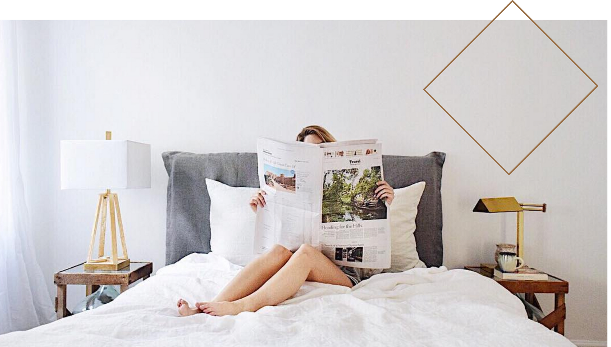 Photo of Jess reading a New York Times article about the challenges that climate change presents in bed