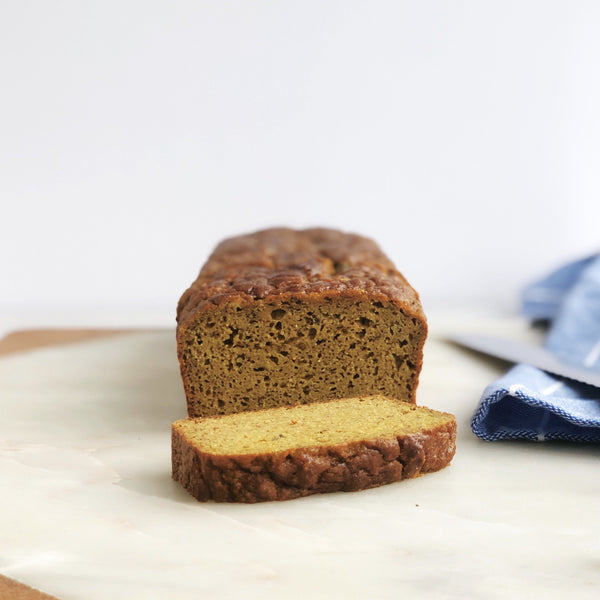 Recipe for Golden Grain-free Banana Bread made with JOYÀ Glow turmeric elixir blend on the blog at joya.ca.