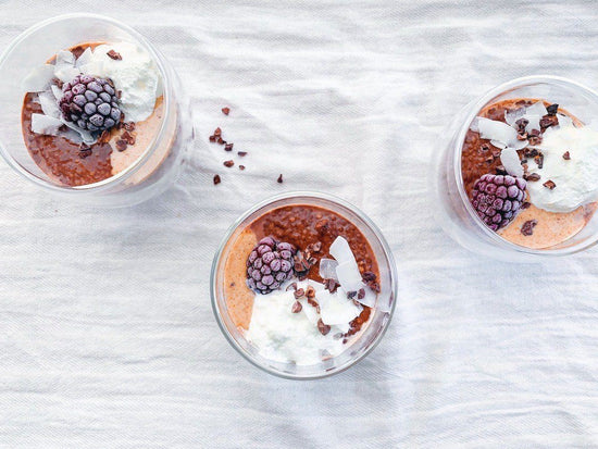 three cups of vegan chia pudding form above