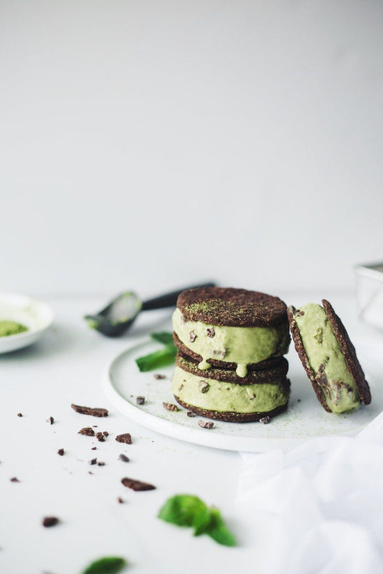 matcha mint chip ice cream sandwich on white plate with chocolate sprinkled