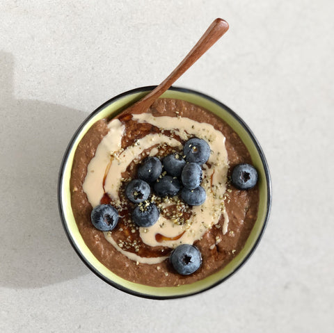 Grain-free cocoa-tahini hot cereal recipe with JOYÀ Bliss cacao elixir blend