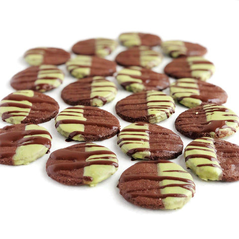 A tray full of JOYA's Matcha Mint Chocolate Cookies drizzled with chocolate