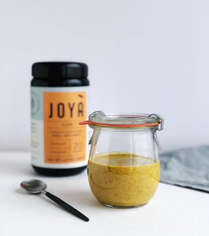Image of JOYÀ rice pudding in small jar flavored with Glow Turmeric elixir blend