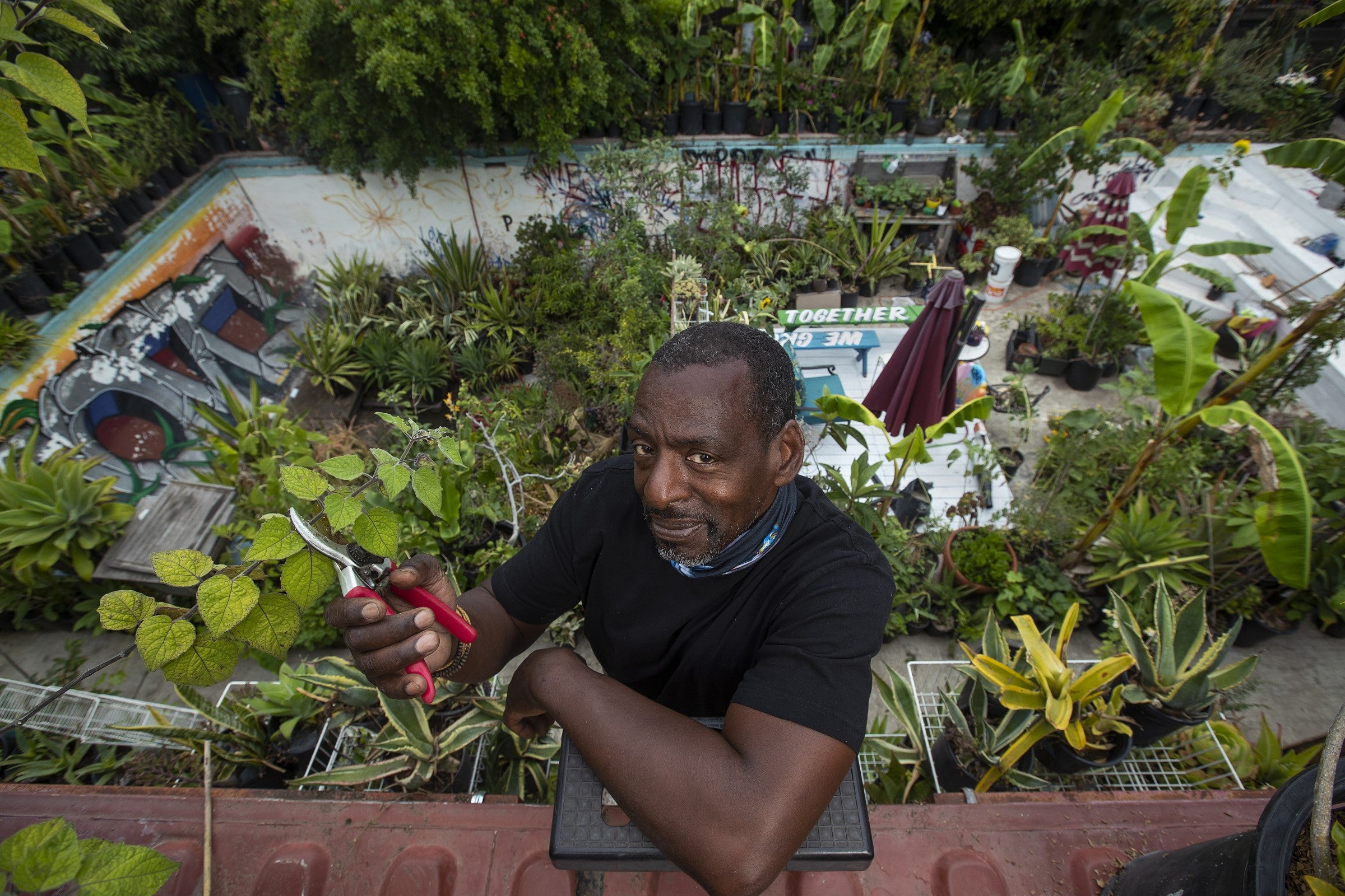 Ron Finley with his in pool garden in the background