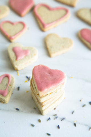 lavender cookies in heart shapes iced in different ways