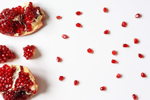 broken pomegranate with scattered seeds