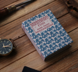 Wallets disguised as antique literature (Kickstarter Project)