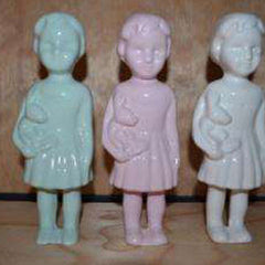 Handmade ceramic standing dolls in various colours