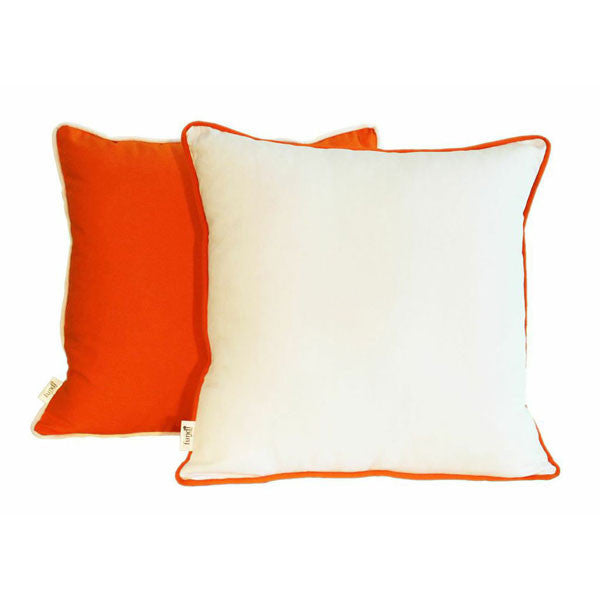 A white scatter cushion with orange piping or orange with white piping