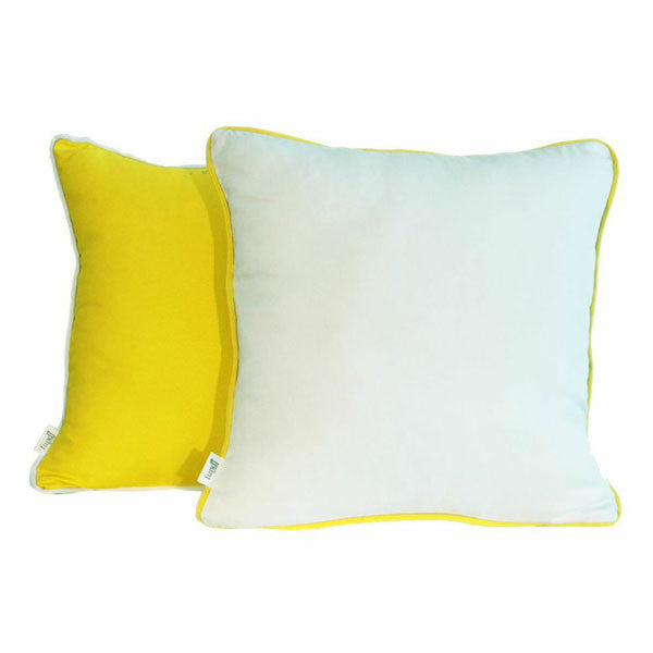 A white scatter cushion with yellow piping or yellow with white piping