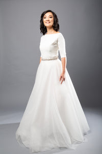 Gorgeous bridal gowns for all body shapes: plus size, curvy, or petite brides. Try on our wedding dresses at home. Size 0-30. Comfortable. Convenient. Fun. Lace or satin. Mermaid or A-line. This crepe bateau-neck top gives polish to any look and offers extra coverage with its three-quarter length sleeves. Tulle A-Line skirt that offers a soft volume for increased interest and romance as you glide through your wedding.