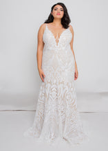 Load image into Gallery viewer, Gorgeous bridal gowns for all body shapes: plus size, curvy, or petite brides. Try on our wedding dresses at home. Size 0-30. Comfortable. Convenient. Fun. Lace or satin. Mermaid or A-line. The plunging v-neck elongates the neck while the slimming trumpet skirt elongates the legs, giving a completely mesmerizing look.We love how the ivory sequins play against the nude underlay of this skirt and how the embellishment follows the trumpet fit.