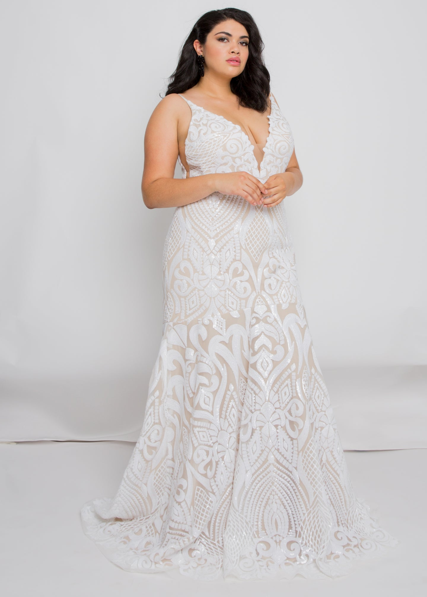 Gorgeous bridal gowns for all body shapes: plus size, curvy, or petite brides. Try on our wedding dresses at home. Size 0-30. Comfortable. Convenient. Fun. Lace or satin. Mermaid or A-line. The plunging v-neck elongates the neck while the slimming trumpet skirt elongates the legs, giving a completely mesmerizing look.We love how the ivory sequins play against the nude underlay of this skirt and how the embellishment follows the trumpet fit.