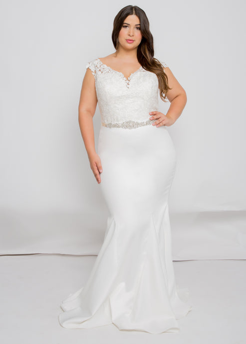 Gorgeous bridal gowns for all body shapes: plus size, curvy, or petite brides. Try on our wedding dresses at home. Size 0-30. Comfortable. Convenient. Fun. Lace or satin. Mermaid or A-line. The way these wide-set straps open up the neckline will lead eyes up along the beautiful lace and to your face. The trumpet skirt with it's sweep train, brings the dress to life. While fitted and figure-flattering, it also offers movement from walking down the aisle, to dancing at your reception.