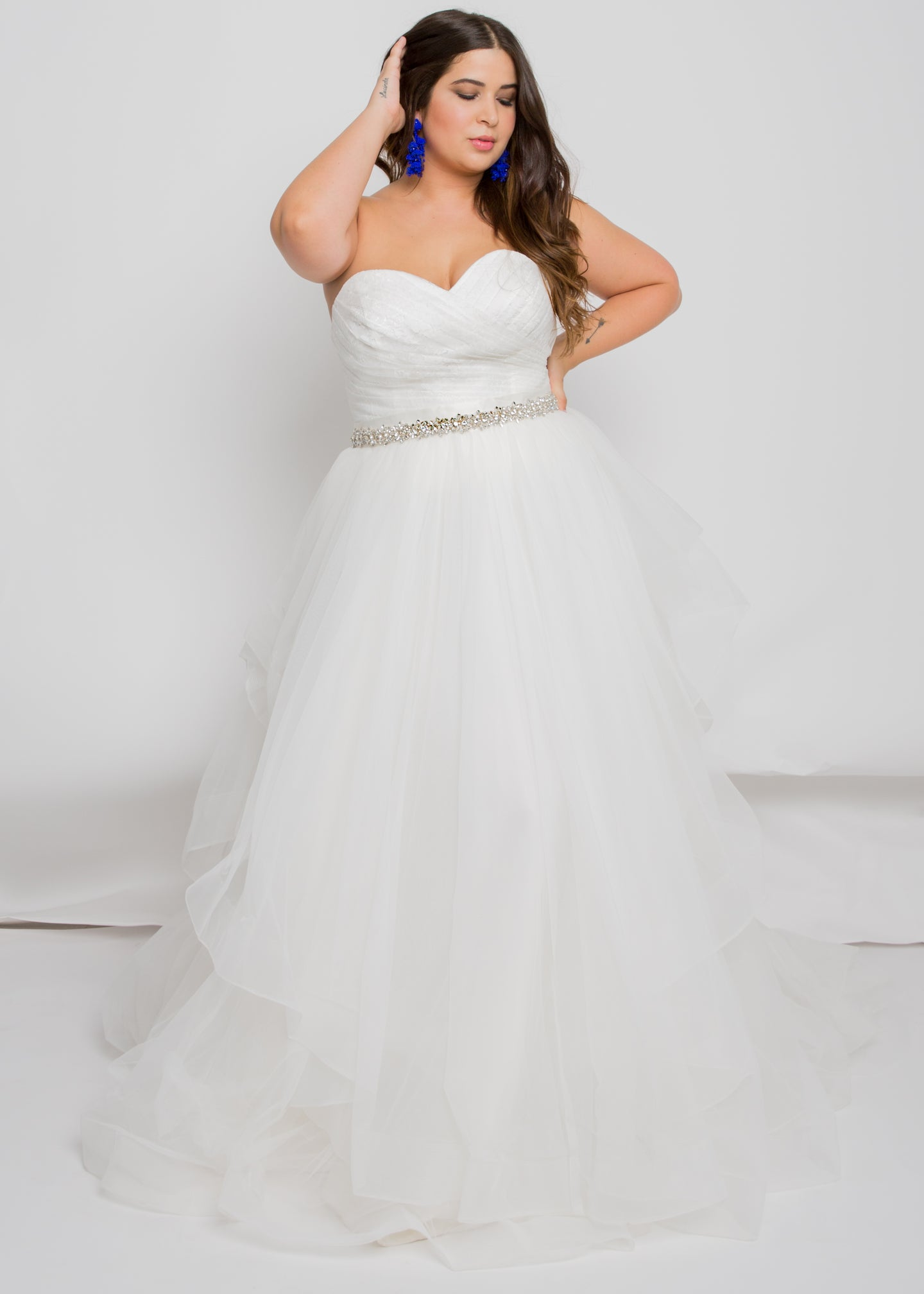 Gorgeous bridal gowns for all body shapes: plus size, curvy, or petite brides. Try on our wedding dresses at home. Size 0-30. Comfortable. Convenient. Fun. Lace or satin. Mermaid or A-line. The textures of the lace and tulle play together beautifully, while the pleating of the top and the layers of the skirt elevate the combination even further. This may at first appear as a simple sweetheart top, but the pleated lace detailing makes it much more than that.