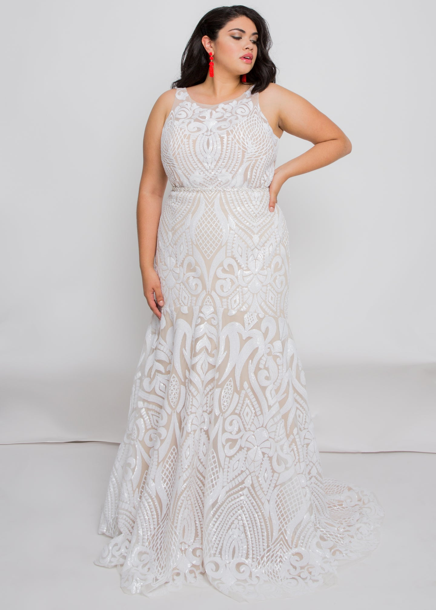 Gorgeous bridal gowns for all body shapes: plus size, curvy, or petite brides. Try on our wedding dresses at home. Size 0-30. Comfortable. Convenient. Fun. Lace or satin. Mermaid or A-line.This high neck top is covered in dreamy ivory sequins that reach around to the open illusion back. We love how the ivory sequins play against the nude underlay of this skirt and how the embellishment follows the trumpet fit.