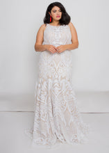 Load image into Gallery viewer, Gorgeous bridal gowns for all body shapes: plus size, curvy, or petite brides. Try on our wedding dresses at home. Size 0-30. Comfortable. Convenient. Fun. Lace or satin. Mermaid or A-line.This high neck top is covered in dreamy ivory sequins that reach around to the open illusion back. We love how the ivory sequins play against the nude underlay of this skirt and how the embellishment follows the trumpet fit.