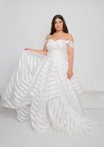 Gorgeous bridal gowns for all body shapes: plus size, curvy, or petite brides. Try on our wedding dresses at home. Size 0-30. Comfortable. Convenient. Fun. Lace or satin. Mermaid or A-line. The sweetheart top's fit will draw in your waist and it's luminous striping will give you a dreamy feeling when you put it on. The striped organza and tiered layers offer a look that is like no other.