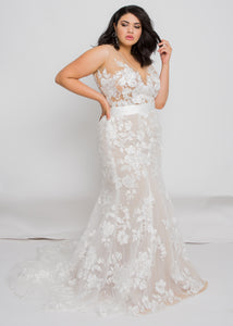 Gorgeous bridal gowns for all body shapes: plus size, curvy, or petite brides. Try on our wedding dresses at home. Size 0-30. Comfortable. Convenient. Fun. Lace or satin. Mermaid or A-line.  The enchanting lace of this combination is met with a sexy edge with the deep v-neck and figure-hugging silhouette. The nude underlay of this top combined with the ivory lace has made us fall in love with it and how it stands out.