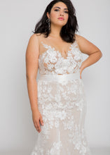 Load image into Gallery viewer, Gorgeous bridal gowns for all body shapes: plus size, curvy, or petite brides. Try on our wedding dresses at home. Size 0-30. Comfortable. Convenient. Fun. Lace or satin. Mermaid or A-line.  The enchanting lace of this combination is met with a sexy edge with the deep v-neck and figure-hugging silhouette. The nude underlay of this top combined with the ivory lace has made us fall in love with it and how it stands out.