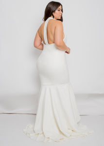 Gorgeous bridal gowns for all body shapes: plus size, curvy, or petite brides. Try on our wedding dresses at home. Size 0-30. Comfortable. Convenient. Fun. Lace or satin. Mermaid or A-line.  This fitted combination will elongate any figure, with head-to-toe beautiful crepe coming in at the waist and smoothing over the hips. The high neck of the Brienne Gown helps to elongate, with an open back as an alluring additional detail.