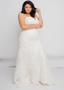 Gorgeous bridal gowns for all body shapes: plus size, curvy, or petite brides. Try on our wedding dresses at home. Size 0-30. Comfortable. Convenient. Fun. Lace or satin. Mermaid or A-line.  The Eva Gown seamlessly blends a luxurious lace pattern with a classic silhouette that follows all the way down to the exquisitely detailed hem. A sweetheart neckline plays perfectly with lace to create one of our most romantic and elegant tops.