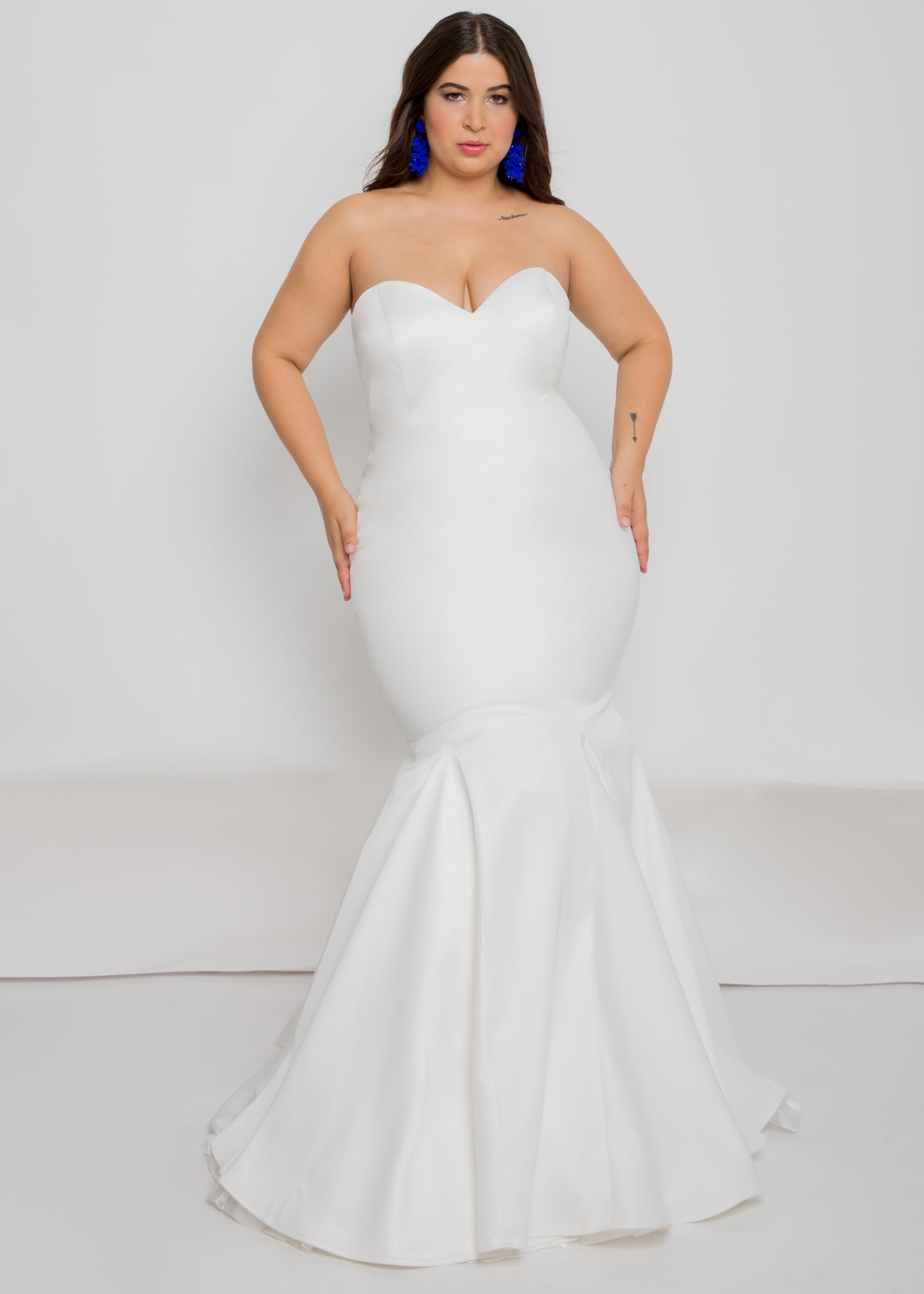 Gorgeous bridal gowns for all body shapes: plus size, curvy, or petite brides. Try on our wedding dresses at home. Size 0-30. Comfortable. Convenient. Fun. Lace or satin. Mermaid or A-line. This strapless satin top has a simple semi-sweetheart neckline and trumpet skirt bring this dress to life. While it's fitted and figure-flattering, it still offers stunning movement.