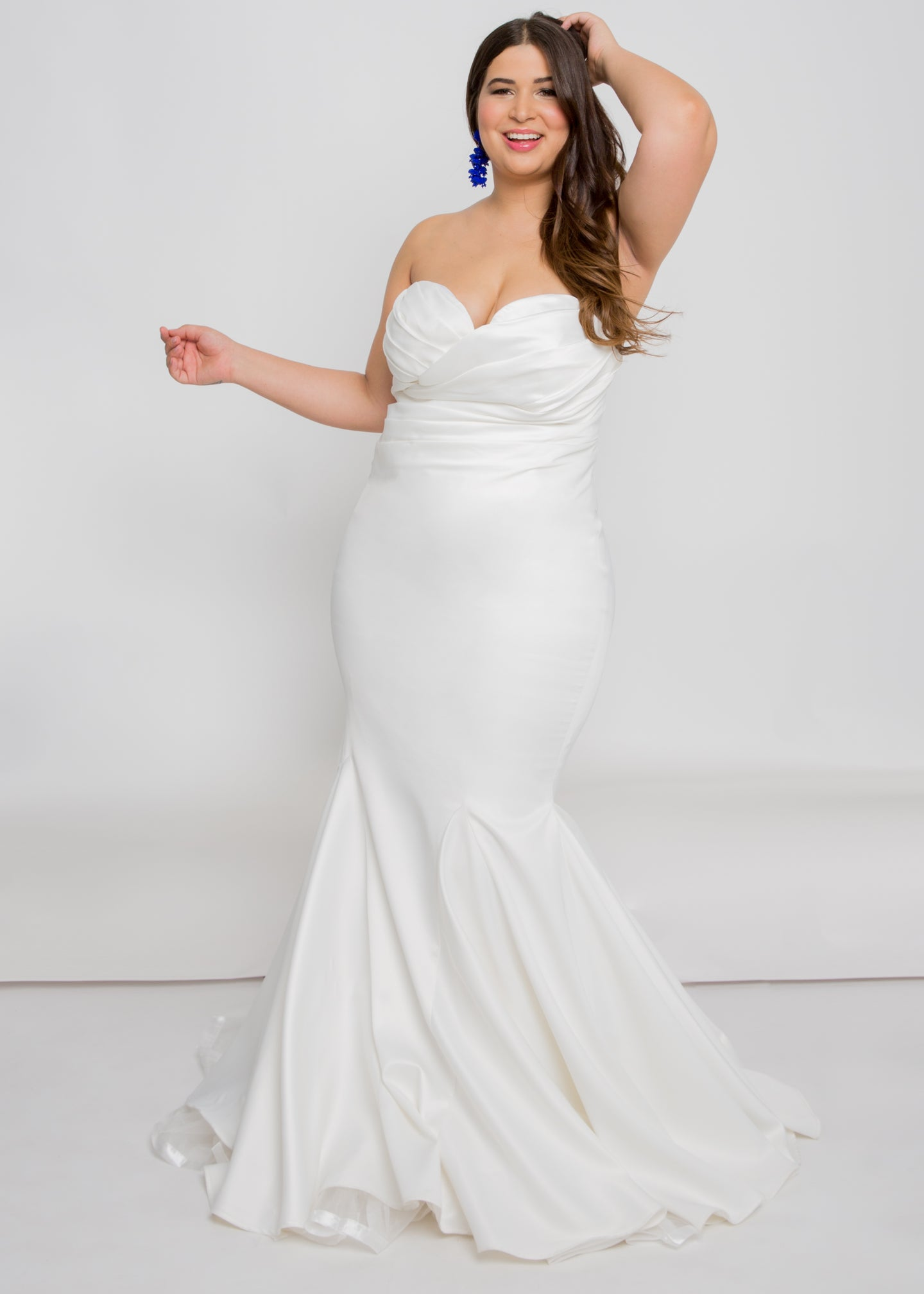 Gorgeous bridal gowns for all body shapes: plus size, curvy, or petite brides. Try on our wedding dresses at home. Size 0-30. Comfortable. Convenient. Fun. Lace or satin. Mermaid or A-line. This strapless sweetheart top complements any figure with its satin ruching. Hooks are available to further customize the dress with sleeves. This trumpet skirt will bring any dress to life.