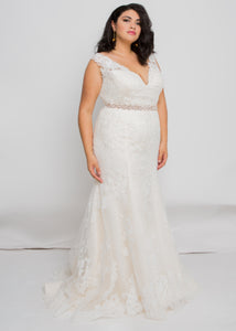 Gorgeous bridal gowns for all body shapes: plus size, curvy, or petite brides. Try on our wedding dresses at home. Size 0-30. Comfortable. Convenient. Fun. Lace or satin. Mermaid or A-line.  The Estelle Gown seamlessly blends a luxurious lace pattern with a silhouette that flatters all the way down to the exquisitely detailed hem. Beautiful illusion strap plays perfectly with lace to create one of our most romantic and elegant tops.