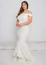 Load image into Gallery viewer, Gorgeous bridal gowns for all body shapes: plus size, curvy, or petite brides. Try on our wedding dresses at home. Size 0-30. Comfortable. Convenient. Fun. Lace or satin. Mermaid or A-line. This modern, straight take on the off the shoulder neckline is unique, with a simple elegance that makes it an easy pair to our skirts. The layered detailing of this trumpet skirt's hemline will dance right along with you.