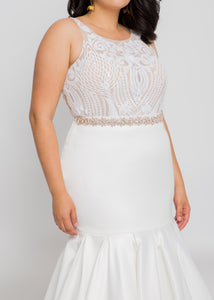 Gorgeous bridal gowns for all body shapes: plus size, curvy, or petite brides. Try on our wedding dresses at home. Size 0-30. Comfortable. Convenient. Fun. Lace or satin. Mermaid or A-line. This high neck top is covered in dreamy ivory sequins that reach around to the open illusion back. This sleek skirt is the perfect balance between elegant satin and the figure-flattering silhouette you have been looking for.