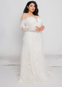 Gorgeous bridal gowns for all body shapes: plus size, curvy, or petite brides. Try on our wedding dresses at home. Size 0-30. Comfortable. Convenient. Fun. Lace or satin. Mermaid or A-line. The illusion off the shoulder silhouette and lace is a perfect pairing that will keep you feeling secure, comfortable, and beautiful. This immaculately detailed trumpet skirt will show off your curves without leaving you feeling constricted.