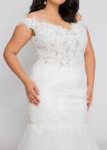 Load image into Gallery viewer, Gorgeous bridal gowns for all body shapes: plus size, curvy, or petite brides. Try on our wedding dresses at home. Size 0-30. Comfortable. Convenient. Fun. Lace or satin. Mermaid or A-line. The thick, detailed lace of this top will look like a dream when custom tailored to you. The off the shoulder neckline will draw all eyes up to your smiling face. This full trumpet skirt will have the same lively effect as other Leigh & Siena trumpet skirts, while fulfilling your lace dress dreams.