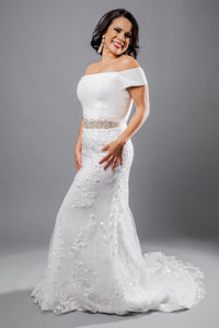 Gorgeous bridal gowns for all body shapes: plus size, curvy, or petite brides. Try on our wedding dresses at home. Size 0-30. Comfortable. Convenient. Fun. Lace or satin. Mermaid or A-line. This crepe off-the-shoulder top offers a graceful and poised look. This is followed by an elegant lace column skirt with a chapel train and eyelash lace patterned hem. Detailed and classic, this skirt will flow beautifully behind you as you walk down the aisle.