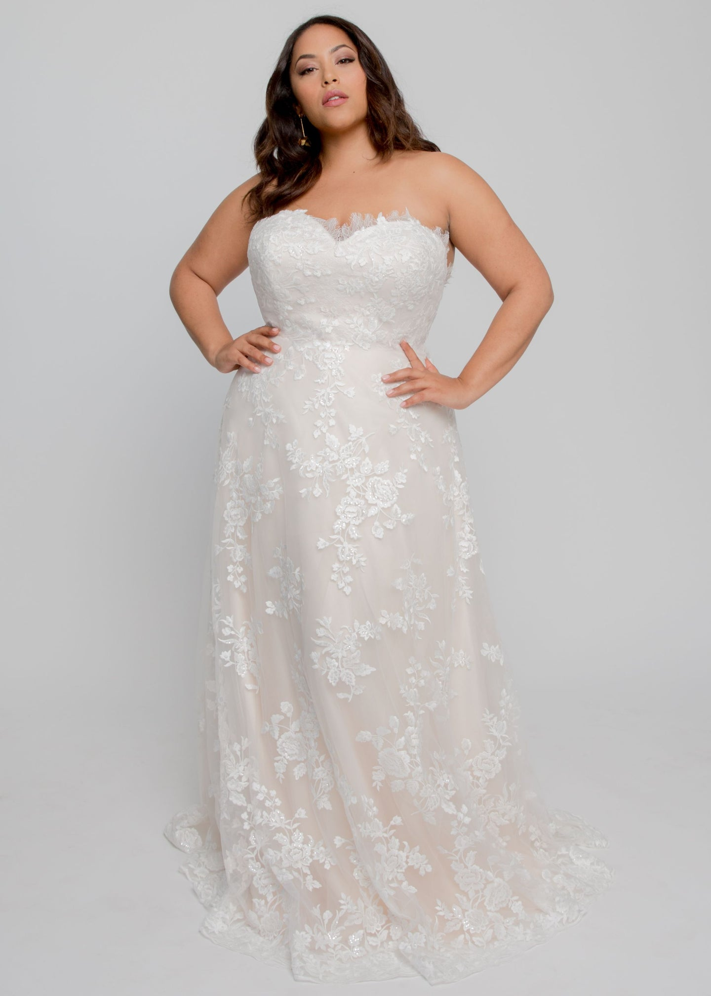 Gorgeous bridal gowns for all body shapes: plus size, curvy, or petite brides. Try on our wedding dresses at home. Size 0-30. Comfortable. Convenient. Fun. Lace or satin. Mermaid or A-line. The Scarlett gown features enchanting lace with a sweetheart neckline and flattering A line skirt. This lace is soft to the touch and features lovely roses covering the dress from neckline to hem.