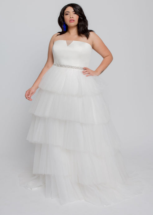 Gorgeous bridal gowns for all body shapes: plus size, curvy, or petite brides. Try on our wedding dresses at home. Size 0-30. Comfortable. Convenient. Fun. Lace or satin. Mermaid or A-line. The Aubrey Gown combines a feminine tulle skirt with a dramatically simple top with a slight plunge in tulle. Beautiful layers of soft tulle contrast with the architectural top to create a chic wedding day look that is perfect for your big day. Style with a jeweled belt if desired.