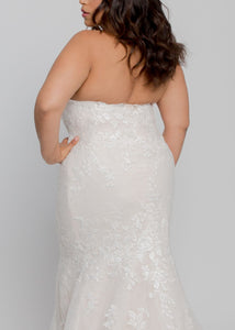Gorgeous bridal gowns for all body shapes: plus size, curvy, or petite brides. Try on our wedding dresses at home. Size 0-30. Comfortable. Convenient. Fun. Lace or satin. Mermaid or A-line. Ivory blooms cascade from lovely sweetheart neckline to a trumpet shape with sweeping chapel train. This lace is soft to the touch and features lovely roses covering the dress from neckline to hem.