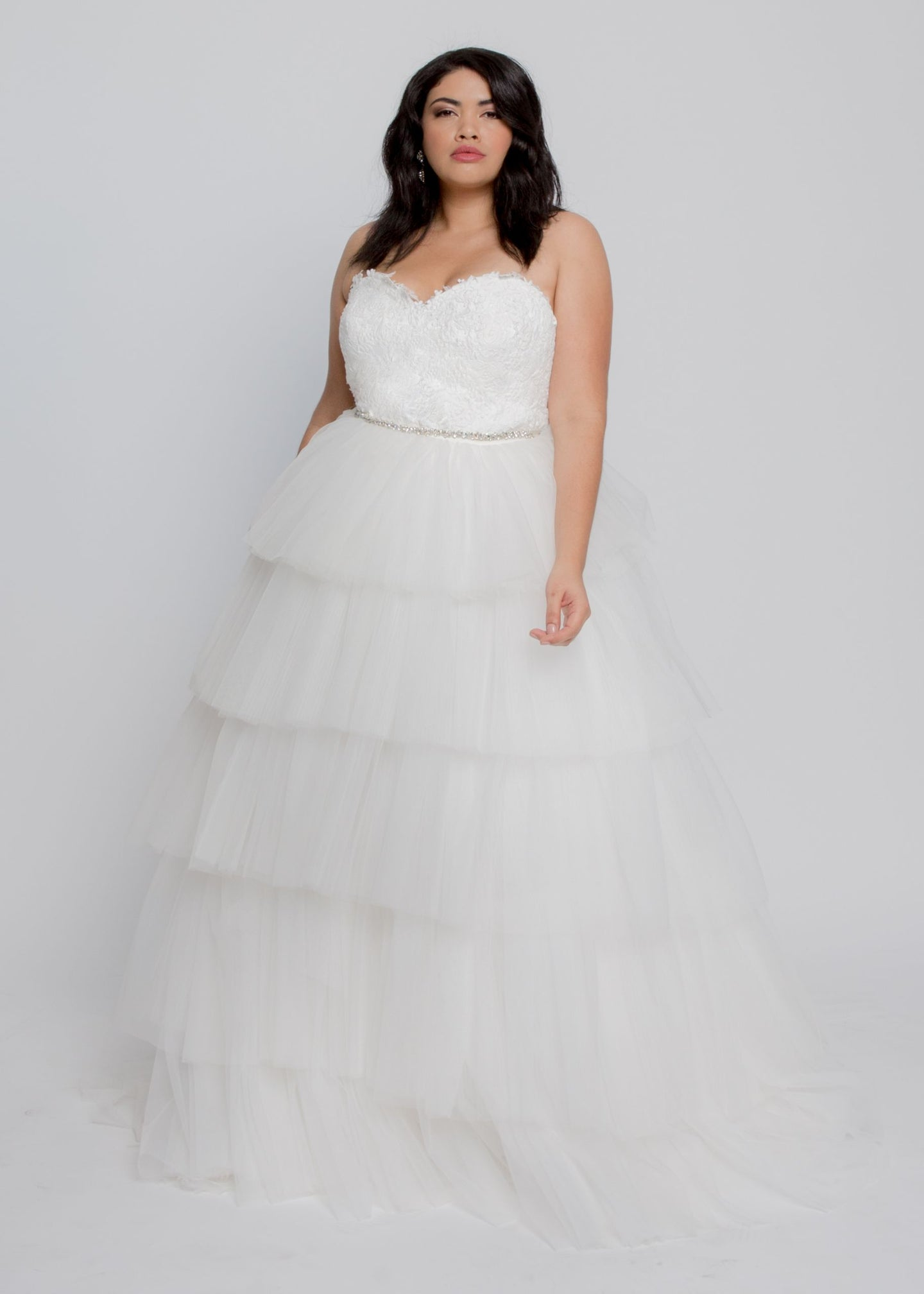 Gorgeous bridal gowns for all body shapes: plus size, curvy, or petite brides. Try on our wedding dresses at home. Size 0-30. Comfortable. Convenient. Fun. Lace or satin. Mermaid or A-line.  The Lillian gown brings pure romance with its lace sweetheart bustier and tulle tiered skirt. The sweetheart features cut out ivory lace, leading layers of perfectly light and airy tulle.