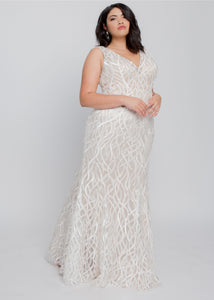 Gorgeous bridal gowns for all body shapes: plus size, curvy, or petite brides. Try on our wedding dresses at home. Size 0-30. Comfortable. Convenient. Fun. Lace or satin. Mermaid or A-line.  This gown was made for the modern bride with its unique embroidered tulle with a sexy V neckline with a custom a line that fits just right. Bring your favorite destination to your special day with ivory vines and understated beading. Shown with a light champagne lining for an illusion look.