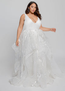 Gorgeous bridal gowns for all body shapes: plus size, curvy, or petite brides. Try on our wedding dresses at home. Size 0-30. Comfortable. Convenient. Fun. Lace or satin. Mermaid or A-line. A gorgeous beaded ball gown meets a clean and modern satin top that is sure to impress. This clean V neck offers support with straps that grow thinner at the shoulder creating a plunging effect. The beaded tier features a horsehair lined hem with flowing organza layers underneath.