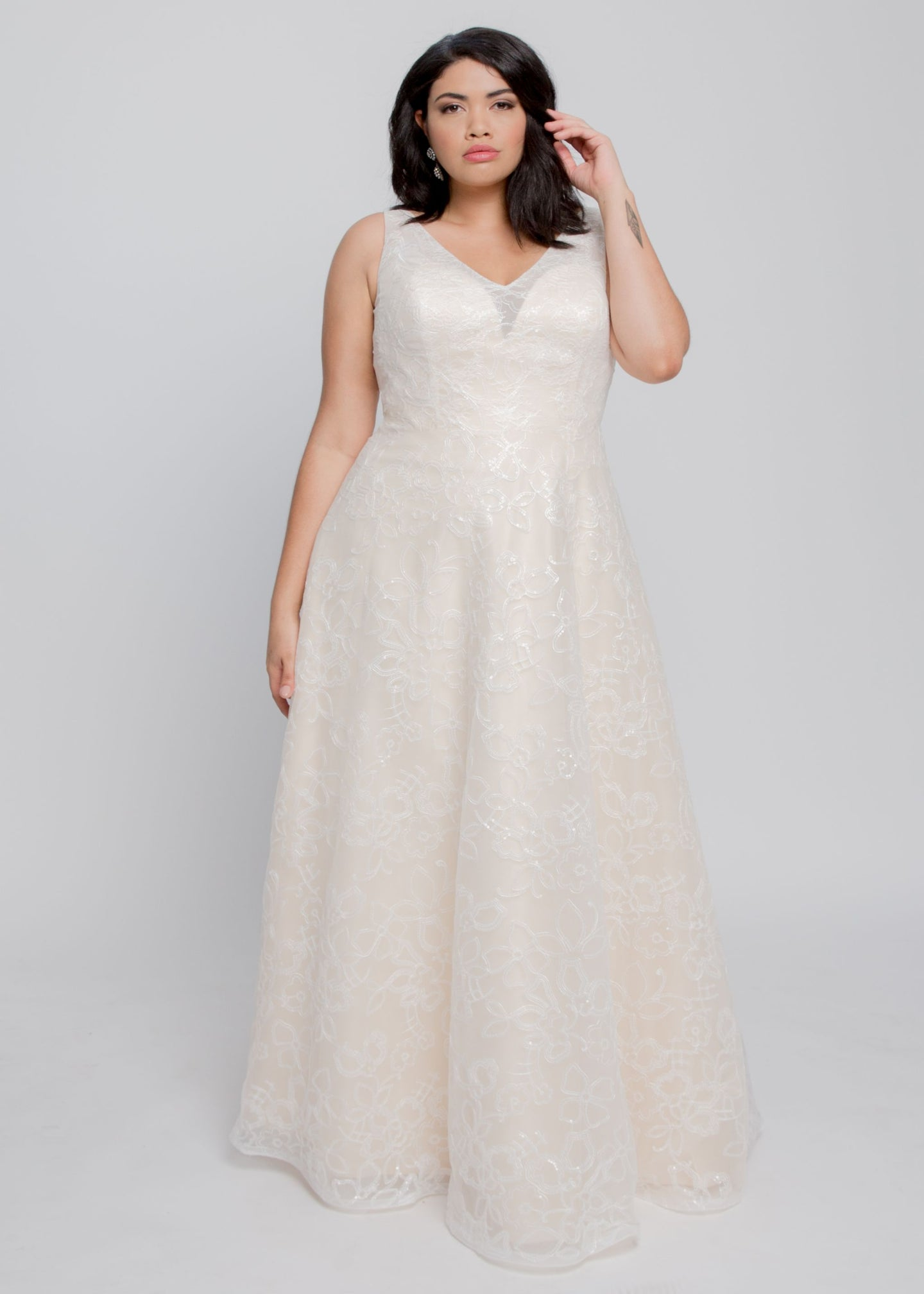 Gorgeous bridal gowns for all body shapes: plus size, curvy, or petite brides. Try on our wedding dresses at home. Size 0-30. Comfortable. Convenient. Fun. Lace or satin. Mermaid or A-line. The Berkeley gown updates a classic shape with wider straps showcasing a flattering V neckline and sweet A line skirt. Champagne lining with beaded, floral fabric adds something special to an elegant gown that will flatter many different silhouettes.
