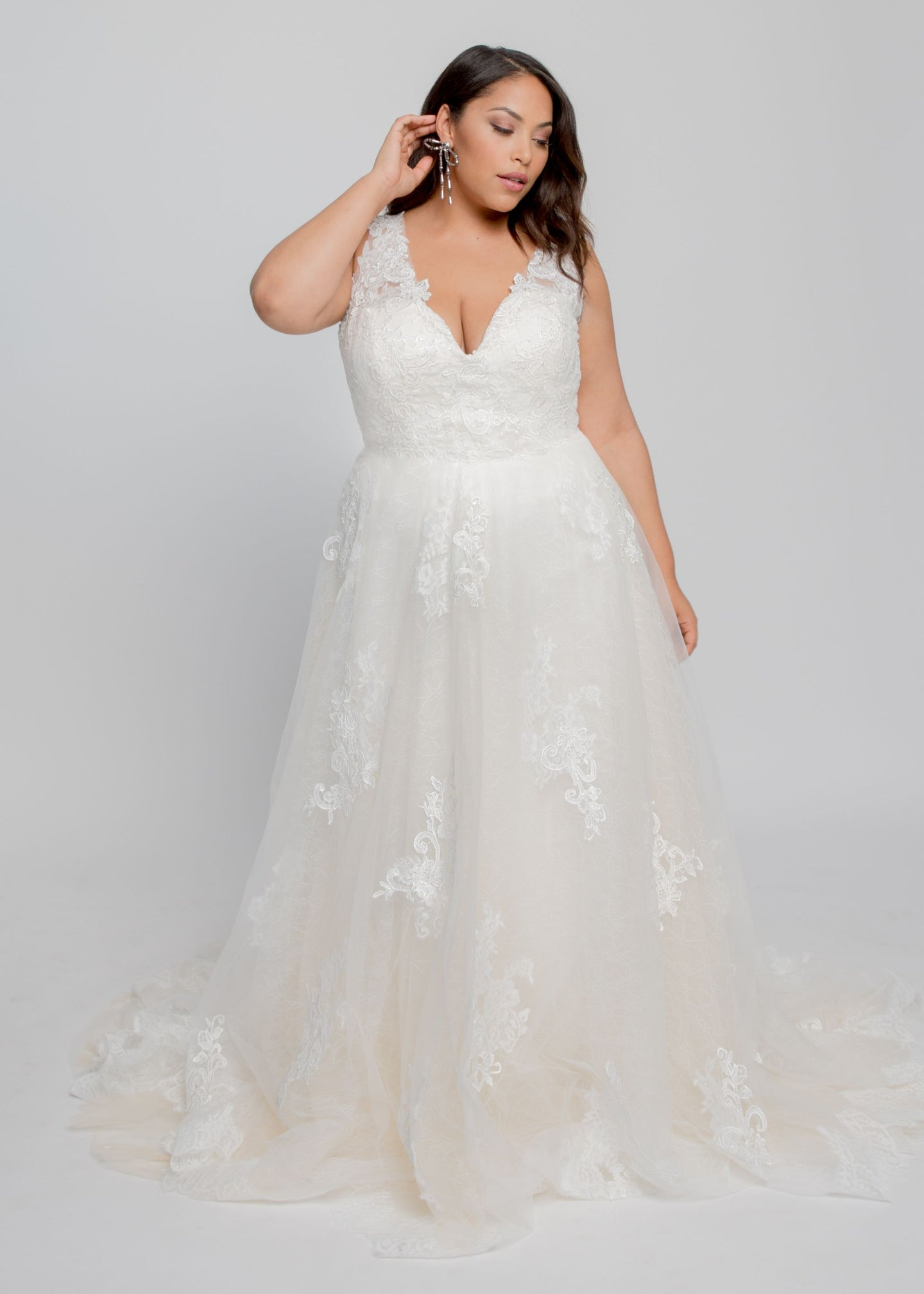 Gorgeous bridal gowns for all body shapes: plus size, curvy, or petite brides. Try on our wedding dresses at home. Size 0-30. Comfortable. Convenient. Fun. Lace or satin. Mermaid or A-line.  Fulfill your lace dreams with this gown featuring a stunning lace-lined V neckline and layered lace and tulle skirt. Romantic illusion lace covers the bodice, while wide straps offer comfort and support. Beautiful appliques on tulle cover additional lace and champagne tulle layers.