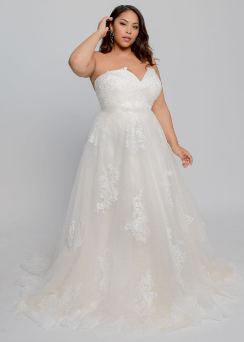 Gorgeous bridal gowns for all body shapes: plus size, curvy, or petite brides. Try on our wedding dresses at home. Size 0-30. Comfortable. Convenient. Fun. Lace or satin. Mermaid or A-line.  Fulfill your lace dreams with this gown featuring a stunning lace-lined sweetheart neckline and layered lace and tulle skirt. A sweetheart neckline plays perfectly with lace to create one of our most romantic and elegant tops. Beautiful appliques on tulle cover additional lace and champagne tulle layers.
