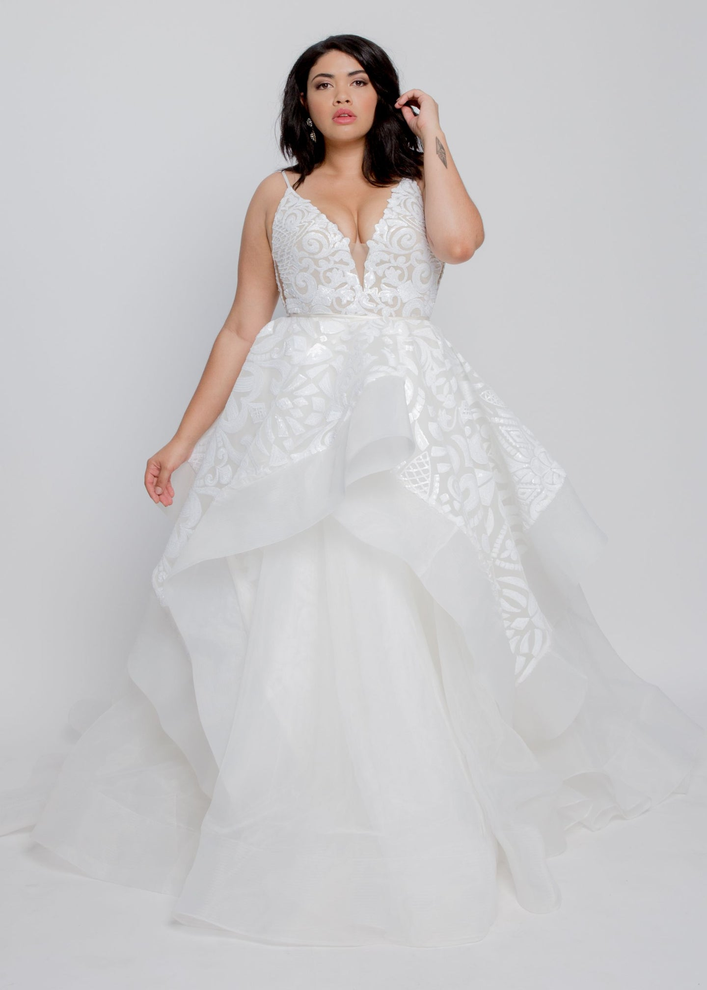 Gorgeous bridal gowns for all body shapes: plus size, curvy, or petite brides. Try on our wedding dresses at home. Size 0-30. Comfortable. Convenient. Fun. Lace or satin. Mermaid or A-line. The alluring and beautiful Courtney Gown features a plunging v-neck elongates the neck while the ball gown skirt creates a mesmerizing look. This intricately detailed sequin-embellished dress is a unique, on-trend ball gown that you will admire long after your wedding day.