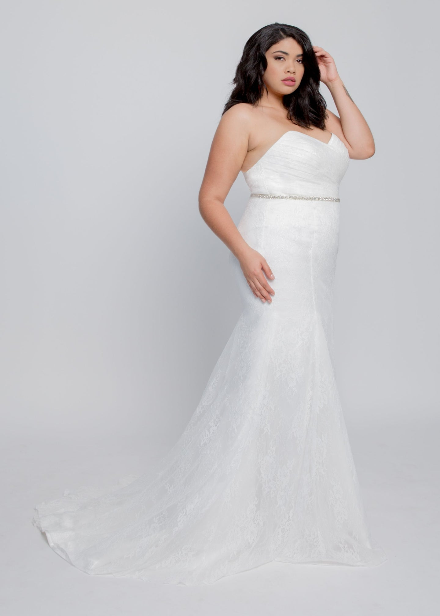 Gorgeous bridal gowns for all body shapes: plus size, curvy, or petite brides. Try on our wedding dresses at home. Size 0-30. Comfortable. Convenient. Fun. Lace or satin. Mermaid or A-line. The Blaire gown combines an elegant plated lace bustier with a sweetheart neckline and figure-flattering trumpet skirt. Glide into your wedding day in lovely lace hugging your body with an elegant chapel train. Customize with detachable lace sleeves to added romance.